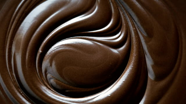 chocolate swirl background, 4k resolution - brown stock videos & royalty-free footage