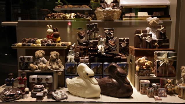 A chocolatier displays Easter chocolates in Brugge, Belgium.