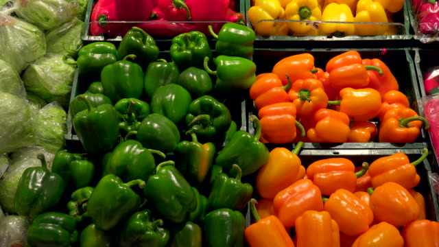 choice of vegetables in a supermarket - market stall stock videos & royalty-free footage