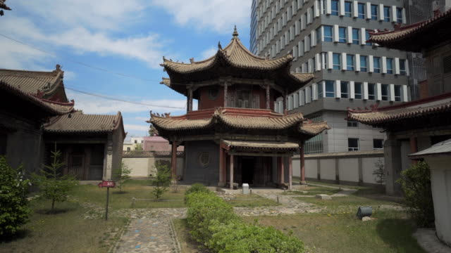 choijin lama temple against modern building in city against sky - ulaanbaatar, mongolia - independent mongolia stock videos & royalty-free footage