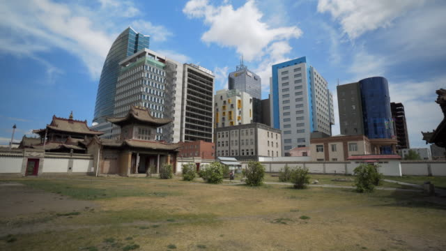 choijin lama temple against modern buildings in city - ulaanbaatar, mongolia - ulan bator stock videos & royalty-free footage