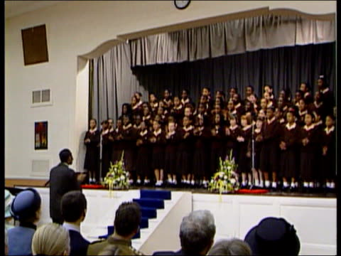 choir falls whilst singing for the queen; itn pool england: london: st martin in the fields school int choir singing and clapping as back section... - choir stock videos & royalty-free footage