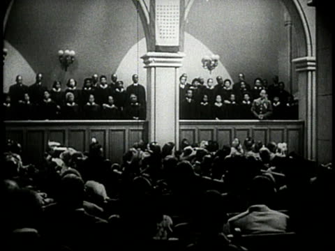 1944 ws choir singing in church during service / usa - congregation stock videos and b-roll footage