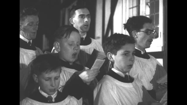 choirboys and young adults in white robes practice 'good king wenceslas' / vs close-ups / the bespectacled minister, in vestments, says the title of... - choir stock videos & royalty-free footage