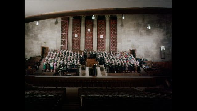 zi a choirmaster conducts practice for a large choir / uk - choir stock videos & royalty-free footage