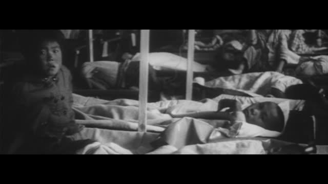 cholera enters japan/korean army santizes town, quarantined hospital, sanitizing fish and vegies, kobe city health department sanitizing the... - medical building stock videos & royalty-free footage