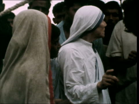 mother teresa interview:; india: west bengal: calcutta: ext mother teresa inspecting mother: also child walks around camp: pakistani refugees... - kolkata stock videos & royalty-free footage