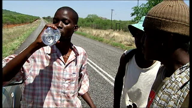 cholera outbreak / worsening situation; south africa: zimbabwe refugees drinking water after crossing border - vibrio stock videos & royalty-free footage