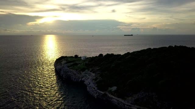 Chong Isariyabhorn (Chong Kao Kad) famous beach sunset point at Sichang island in Thailand.
