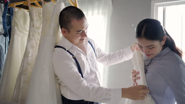 choose a white wedding dress for a woman. in the wedding studio. - white dress stock videos & royalty-free footage