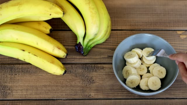 choosing a slice of banana to eat - banana stock videos & royalty-free footage