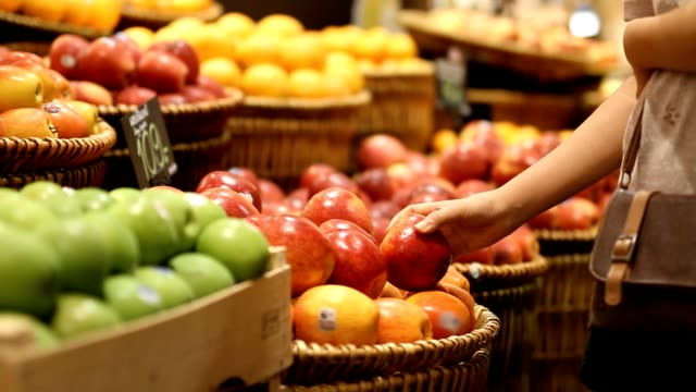 choosing and buying apples at the store - apple fruit stock videos and b-roll footage