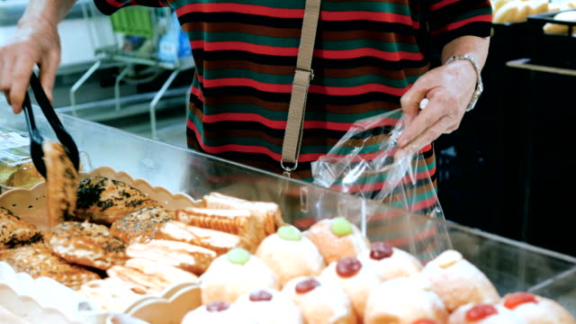 choosing delicious freshly made pastry - choosing stock videos & royalty-free footage