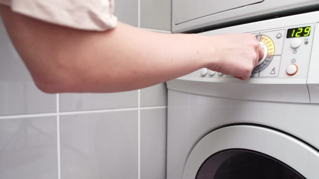 choosing program on washing machine - tumble dryer stock videos & royalty-free footage