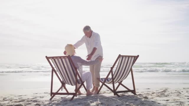 choosing the right retirement plan has it's rewards - deckchair stock videos & royalty-free footage
