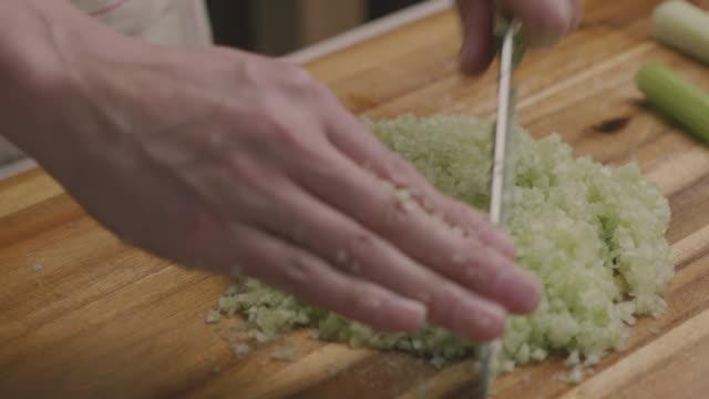 chop celery stick finely for gyoza stuffing - celery stock videos & royalty-free footage