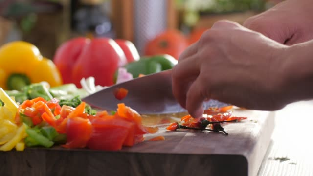 chop vegetables.healthy food. colorful cuisine - peperone video stock e b–roll