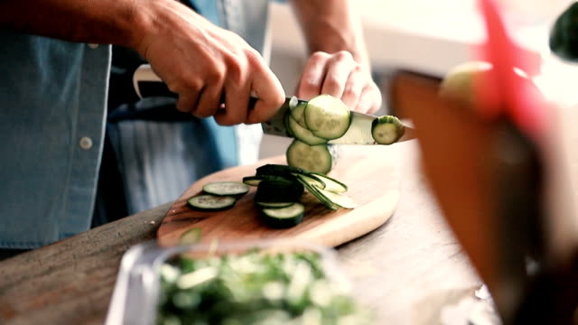 chopped cucumber - kitchen knife stock videos & royalty-free footage