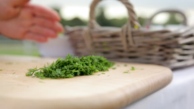 chopped dill on a chopping board - dill stock videos and b-roll footage