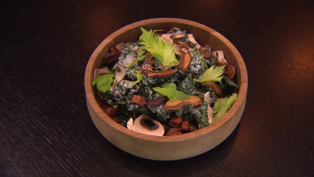 chopped kale salad with shittake mushrooms at rpm steak restaurant in chicago on dec 2014 - kale stock videos and b-roll footage