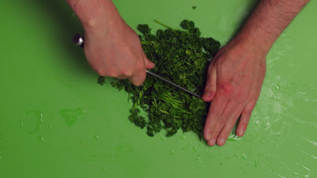 chopped parsley. - parsley stock videos and b-roll footage