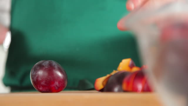 chopped plum in low angle - plum stock videos & royalty-free footage