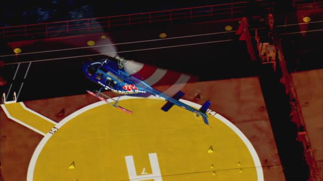 WS ZO TU AERIAL Chopper taking off from bulk freighter, Cairns, Queensland, Australia