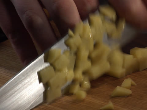 chopping a potato into cubes - unknown gender stock videos & royalty-free footage
