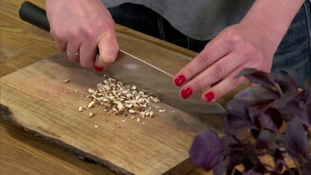 chopping almonds - nut food stock videos & royalty-free footage