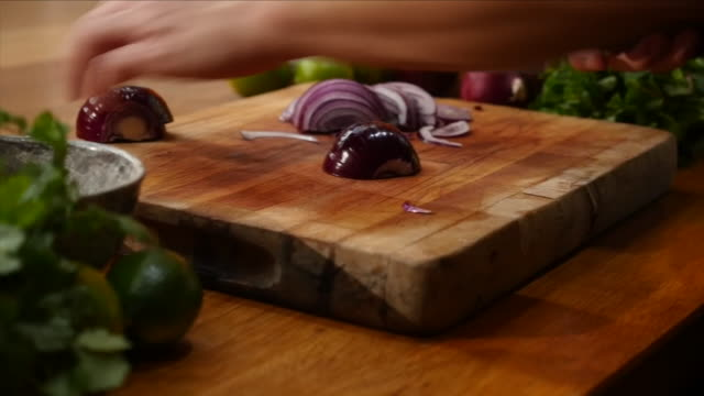 chopping an onion - chopping board stock videos & royalty-free footage