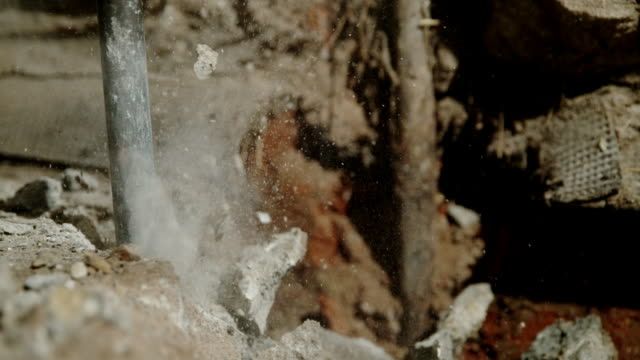 slo mo chopping away the floor with a jackhammer - concrete stock videos & royalty-free footage