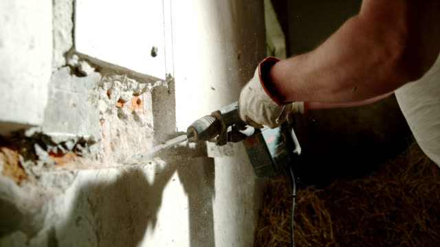 slo mo chopping away the wall with a jackhammer - drill bit stock videos and b-roll footage