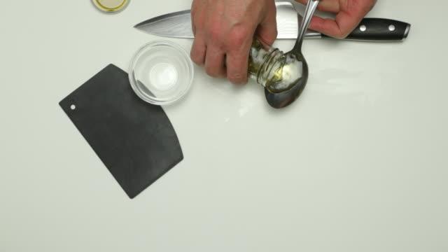 chopping capers. - annick vanderschelden stock videos & royalty-free footage