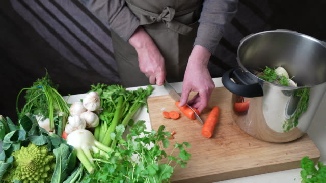 chopping carrot - broth stock videos & royalty-free footage