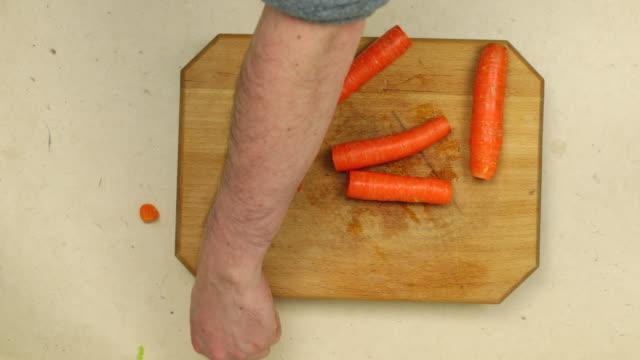 Chopping carrots.