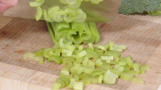 chopping celery - celery stock videos & royalty-free footage