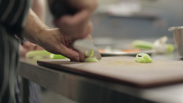 chopping celery - celery stock videos and b-roll footage