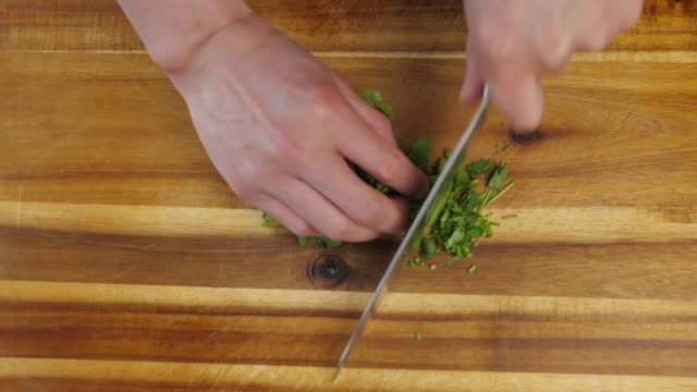 chopping coriander - chopped stock videos and b-roll footage