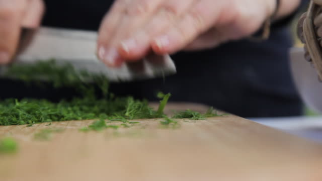 chopping dill on a chopping board - dill stock videos and b-roll footage