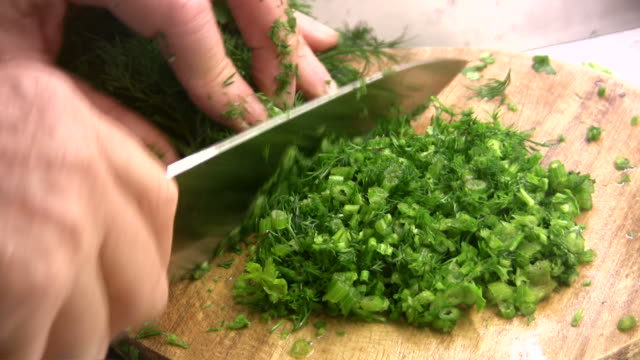 chopping dill - dill stock videos and b-roll footage