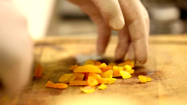 chopping dried apricots