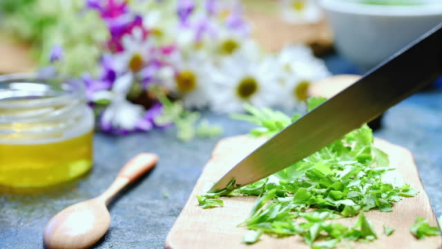 chopping fresh green parsley - penknife stock videos & royalty-free footage