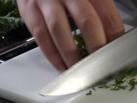 chopping fresh parsley with a chef's knife - parsley stock videos and b-roll footage