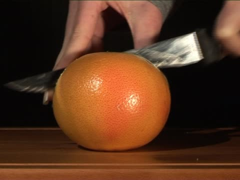 chopping grapefruit 3 - chopped food stock videos and b-roll footage