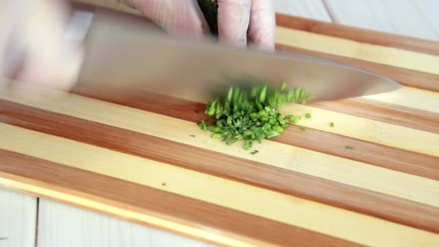 chopping green dill. - bunch stock videos and b-roll footage