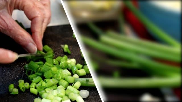 vídeos y material grabado en eventos de stock de picar cebollas verdes en una tabla de cortar. cebollino - pantalla dividida