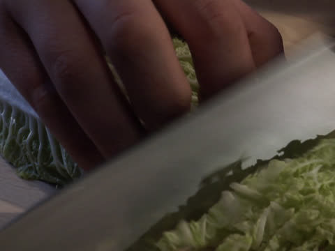 chopping lettuce on a wooden board - unknown gender stock videos & royalty-free footage