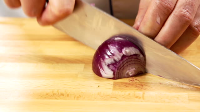 chopping onion - slow mo - onion stock videos & royalty-free footage
