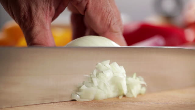 chopping onion - onion stock videos & royalty-free footage
