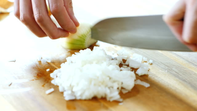 chopping onion - cutting stock videos & royalty-free footage